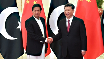 China's President Xi Jinping, right, shakes hands with Pakistan's Prime Minister Imran Khan before a meeting at the Great Hall of the People in Beijing Sunday, April 28, 2019.