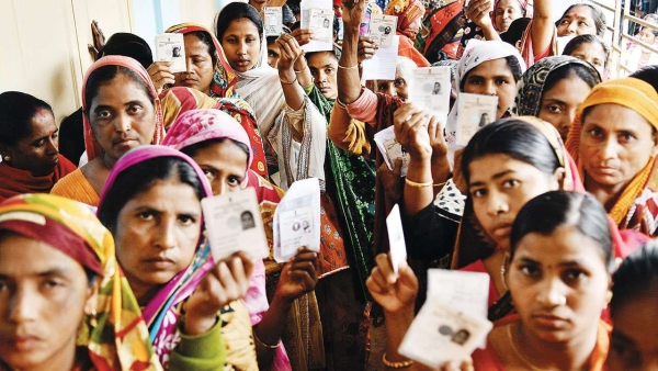 Voters standing in a queue to vote.