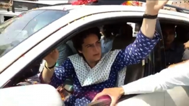 Amethi (UP): Congress General Secretary Priyanka Gandhi Vadra greets supporters on her arrival in Amethi, Uttar Pradesh on April 19, 2019. She will hold a party workers meeting in Gauriganj, the district headquarters of Amethi, on Friday ahead of her roadshow in Kanpur later in the day. (Photo: IANS)