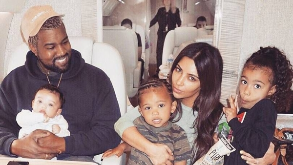 Kim Kardashian with hubby Kanye West and all their kids. From L to R, Chicago, Saint, North.
