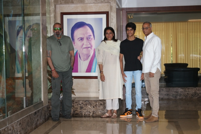 Sanjay Dutt, Priya Dutt and her husband and son pose besides a portrait of Sunil Dutt.