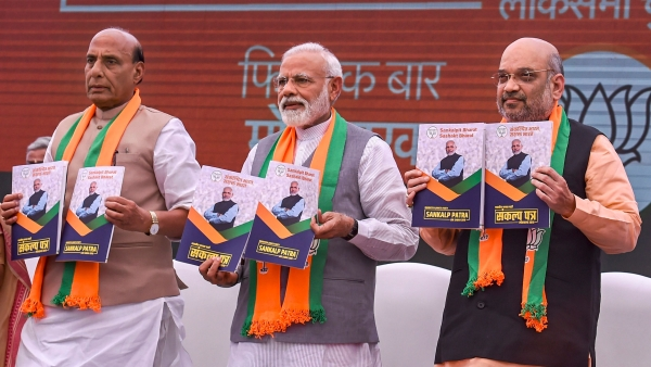Prime Minister Narendra Modi, BJP President Amit Shah and Union Home Minister Rajnath Singh release Bharatiya Janata Party's (BJP) manifesto (<i>Sankalp Patra</i>) for the Lok Sabha elections 2019.