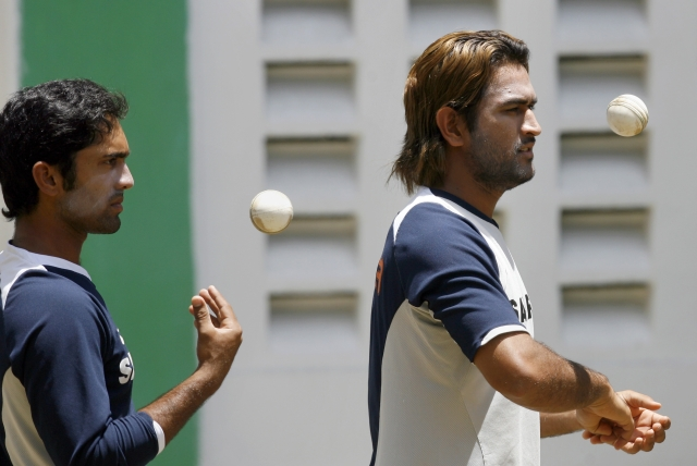India's Mahendra Dhoni (R) and Dinesh Karthik at a training session in the Port of Spain during the 2007 World Cup.