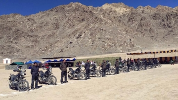 The 11 riders line up during the flag-in ceremony in Leh.