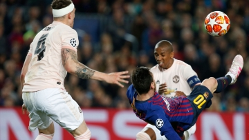 Barcelona forward Lionel Messi tries to score with a bicycle kick during the Champions League quarterfinal, second leg, soccer match between FC Barcelona and Manchester United at the Camp Nou stadium in Barcelona.
