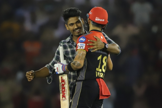 A fan hugs Virat Kohli during RCB's IPL 2019 match against KXIP.