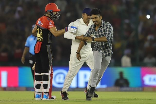Virat Kohli with a fan during RCB's IPL 2019 match against KXIP.