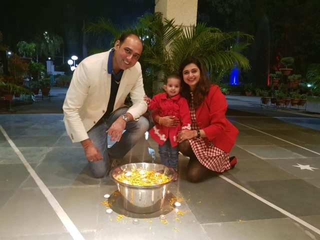 Neha, with her husband Varun Mmonga, and their two-year-old daughter.