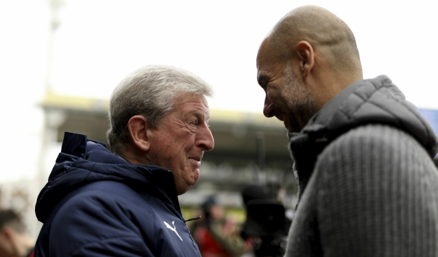 Crystal Palace manager Roy Hodgson (left) and Manchester City manager Pep Guardiola (right) before kick-off during the Premier League match at Selhurst Park, London.