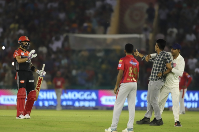 Virat Kohli waves a fan goodbye during RCB's IPL 2019 match against KXIP.