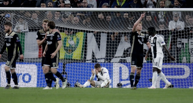 Juventus' Cristiano Ronaldo, center, reacts during the Champions League, quarterfinal, second leg soccer match between Juventus and Ajax, at the Allianz stadium in Turin, Italy, Tuesday, April 16, 2019.