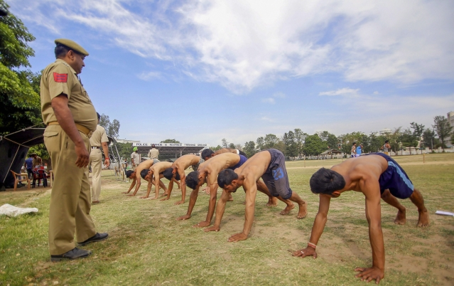 Candidates during a physical fitness test for the post of Special Police Officers (SPO), at Gulshan Ground in Jammu, on 7 May.