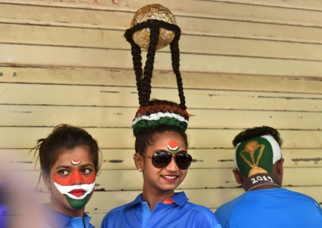 Cricket fans get a haircut done to cheer for team India ahead of the ICC Cricket World Cup 2019, in Mumbai.