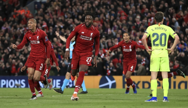 Liverpool's Divock Origi celebrates scoring his side's fourth goal of the game during the UEFA Champions League Semi Final, second leg match at Anfield, Liverpool. PRESS ASSOCIATION Photo. Picture date: Tuesday May 7, 2019.