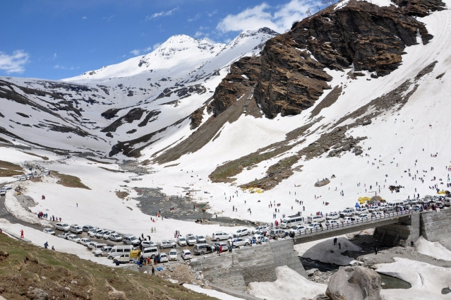 Tourists flock the Rohtang pass, a popular destination for North Indians looking to escape the summer heat, after it opened for public on Sunday, 5 May.