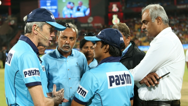 Umpires have a discussion during an IPL 2019 fixture.