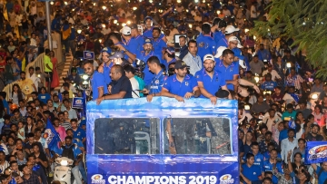 Mumbai Indians celebrate IPL 2019 title with an open bus parade in Mumbai.