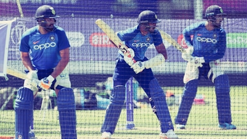 India's Rohit Sharma, left, Vijay Shankar, center, and Lokesh Rahul bat in the nets during a training session at The Oval in London, Thursday, May 23, 2019. The Cricket World Cup starts on Thursday 30 May 30.
