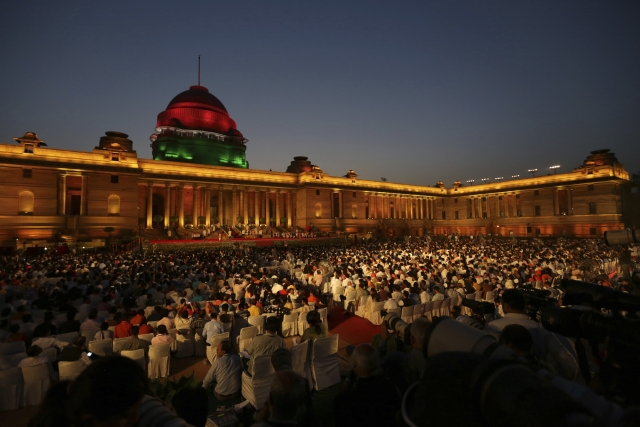 Guests watch the swearing-in ceremony of Narendra Modi, who took oath for a second term as India's prime minister at the forecourt of the Rashtrapati Bhavan in New Delhi.
