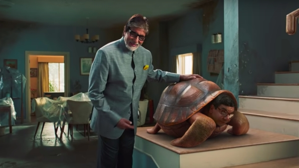 A still from the Ad campaign featuring Amitabh Bachchan with a Giant Turtle