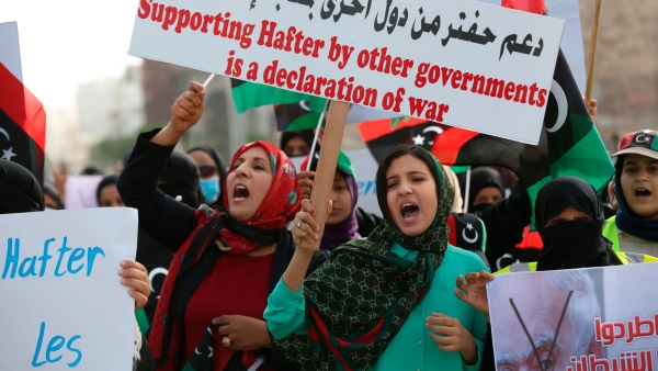 Protesters march chant slogans against military operations by Field Marshal Khalifa Hifter's forces in Martyrs' Square on in Tripoli, Libya on Friday, April 26, 2019.