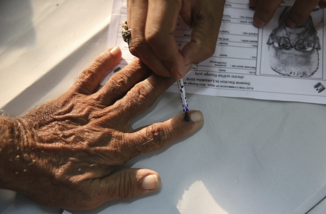An elderly citizen gets ink mark on his finger prior to voting at a polling center during the fourth phase of general elections in Mumbai, on Monday, 29 April 2019. The voting over seven phases ends on 19 May, with counting scheduled for 23 May.