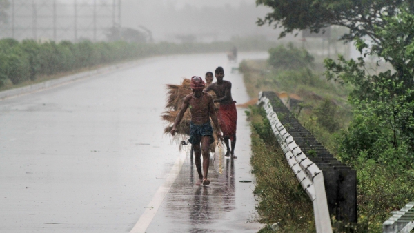Villagers move to safer places amidst gusty winds ahead of the landfall of cyclone Fani on the outskirts of Puri.