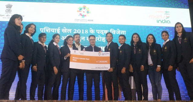 Kiren Rijiju facilitates Indian women's kabaddi team that clinched silver a medal at the 18th Asian Games; in New Delhi, on Sept 4, 2018.