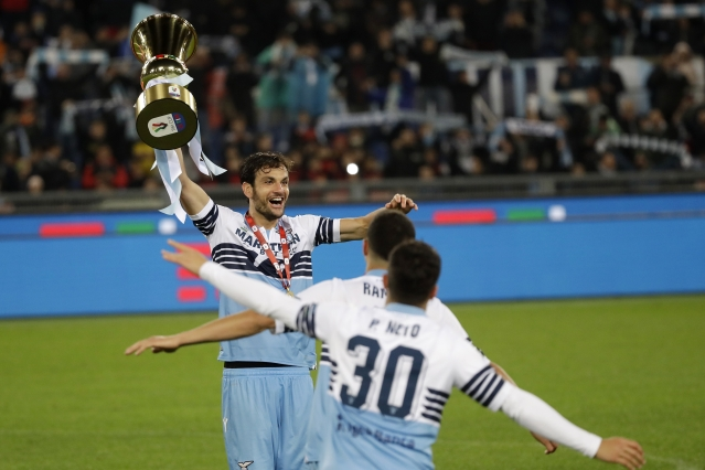Lazio's Marco Parolo, top left, holds up the Italian Cup trophy at the end of the final match between Lazio and Atalanta.