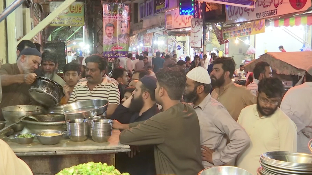 After midnight, street vendors open shop in Rawalpindi, selling a selection of food during the holy month of Ramzan.
