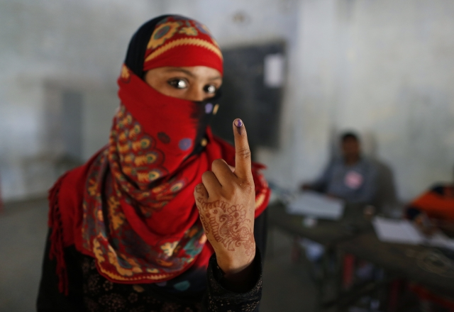 An Indian woman displays the indelible ink mark on her finger after casting her vote in Kausambi district of Uttar Pradesh. Voters cast their ballots on Monday in the crucial fifth phase of India's marathon elections.