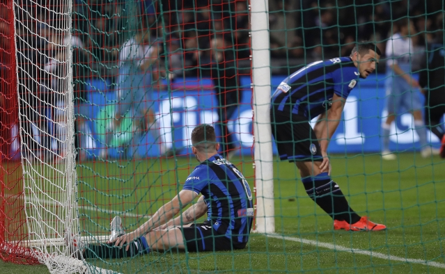 Atalanta's Robin Gosens, left, and Atalanta's Remo Freuler reacts after Lazio's Joaquin Correa scored during the Italian Cup soccer final match.
