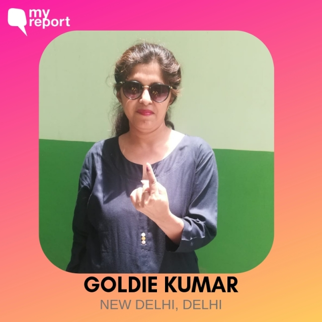 Goldie Kumar poses for a photo after voting.