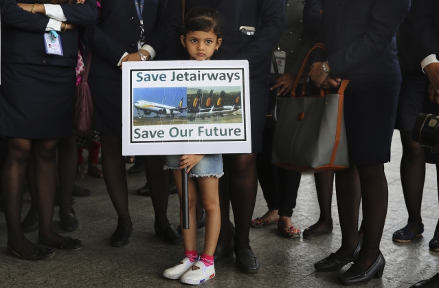 Daughter of a Jet Airways employee holds a placard at a silent protest organised by employees at the Chhatrapati Shivaji Maharaj International Airport Mumbai, India, Wednesday, 1 May 2019.
