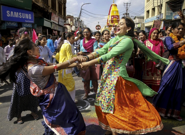 Devotees dance in celebration during Rath Yatra organised by ISKCON temple, in Jammu, Thursday, 2 May 2019.