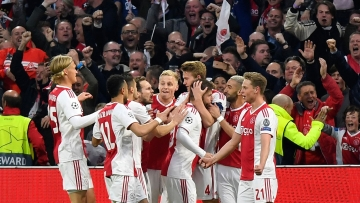 Ajax's Matthijs de Ligt celebrates with teammates after scoring his side's opening goal during the Champions League semifinal second leg soccer match between Ajax and Tottenham Hotspur.