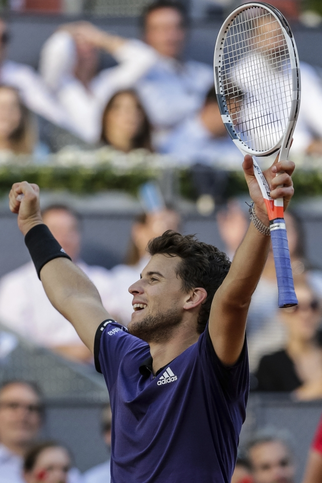 Austria's Dominic Thiem celebrates his victory against Roger Federer in the Madrid Open.