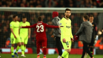 Barcelona's Lionel Messi leaves the playing field after losing the Champions League semifinal, second leg, soccer match against Liverpool at the Anfield stadium in Liverpool, England, Tuesday, May 7, 2019.