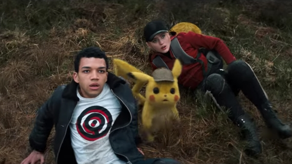 Justice Smith and Kathryn Newton and Pikachu in a still from P<i>okémon Detective Pikachu.</i>