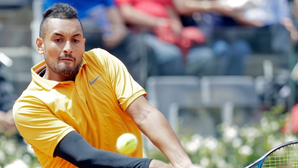 Nick Kyrgios of Australia returns the ball to Daniil Medvedev of Russia at the Italian Open tennis tournament, in Rome, Tuesday, May, 14, 2019. Kyrgios won 6-3, 3-6, 6-3.