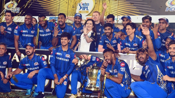 Mumbai Indians players celebrate their fourth IPL title.