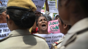 Indian women activists shout slogans during a protest against a court inquiry that cleared India's Chief Justice of sexual harassment allegations made by a former employee at his official residence, in New Delhi.