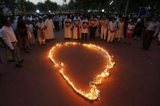 Indians make an outline of Sri Lankan map with lighted candles after a peace march to express solidarity with people of Sri Lankan, in Ahmadabad on Sunday, 28 April 2019.