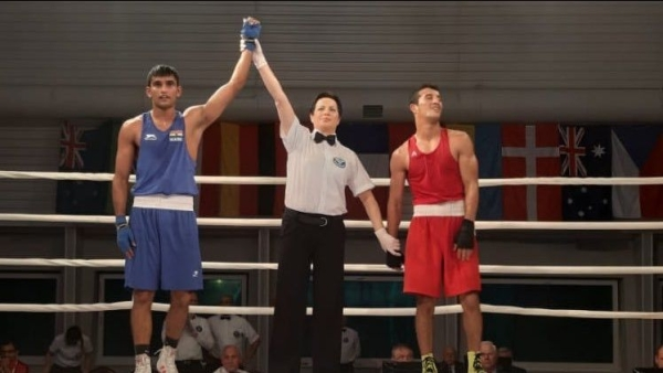 Indian boxer Manish Kaushik wins gold in the XXXVI Feliks Stamm International Boxing Tournament against Morocco's Mohamed Hamout.
