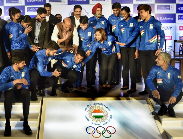 Rajnath Singh and  Kiren Rijiju during a send-off ceremony for Indian athletes before the 2018 Commonwealth Games.