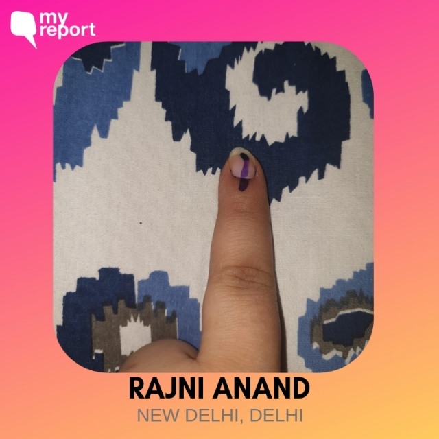 Rajni Anand shows off her inked finger.