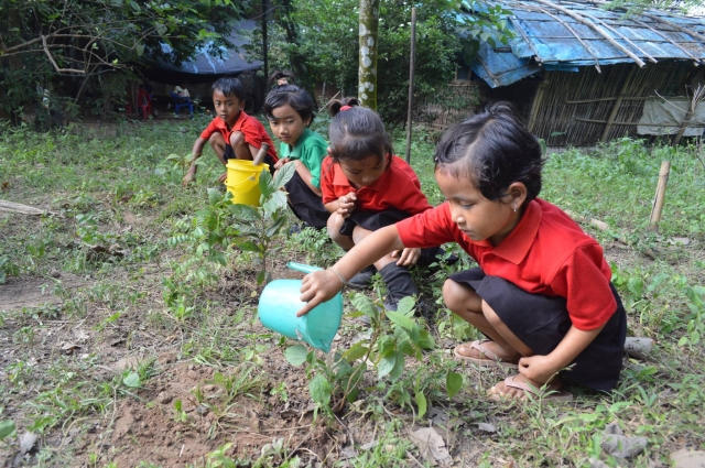 Students planting trees at Akshar School.