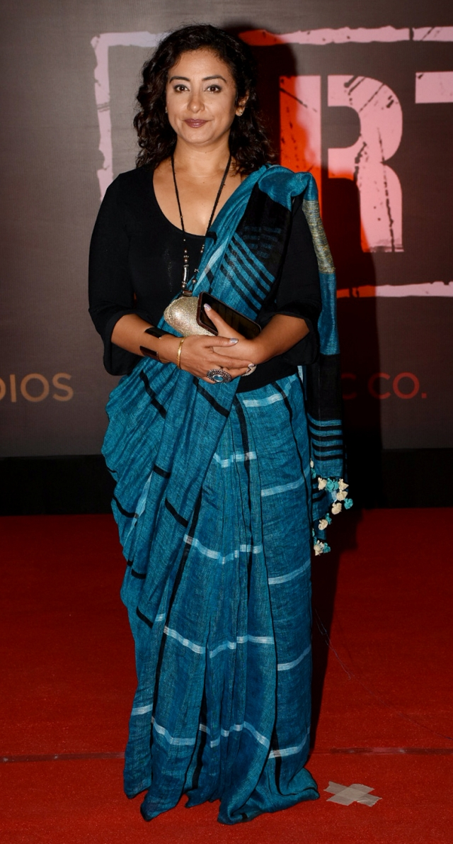 Actor Divya Dutta in a beautiful blue sari.