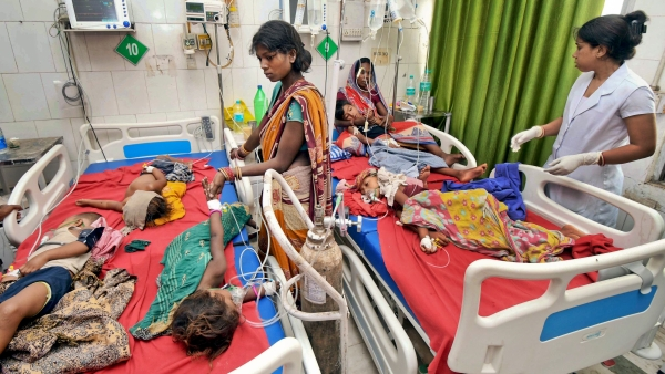 Children showing symptoms of Acute Encephalitis Syndrome undergo treatment at Sri Krishna Medical College Hospital in Muzaffarpur, Bihar.