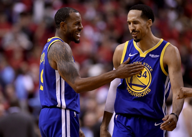 Golden State Warriors forward Andre Iguodala (9) and teammate Shaun Livingston (34) celebrate their win against the Toronto Raptors.